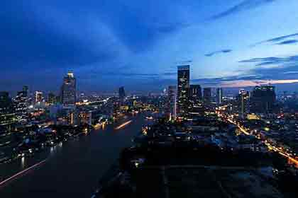 A photo of the Bangkok skyline during twilight hour